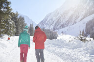 Couple walking in snow-covered landscape - CVF00478