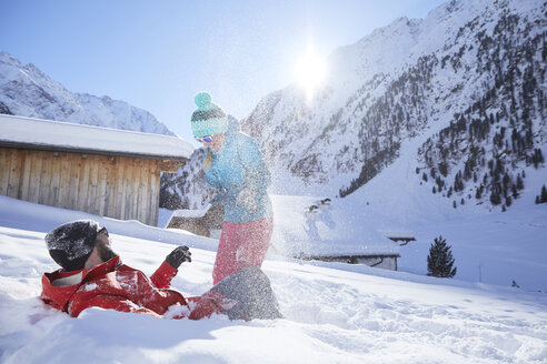 Active couple having fun in snow-covered landscape - CVF00487