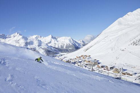Austria, Tyrol, Kuehtai, man skiing in winter landscape - CVF00499