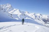 Austria, Tyrol, Kuehtai, skier in winter landscape - CVF00502