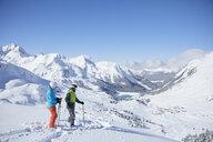 Austria, Tyrol, Kuehtai, two skiers in winter landscape - CVF00505
