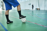 Close-up of indoor soccer player with ball - ZEDF01410