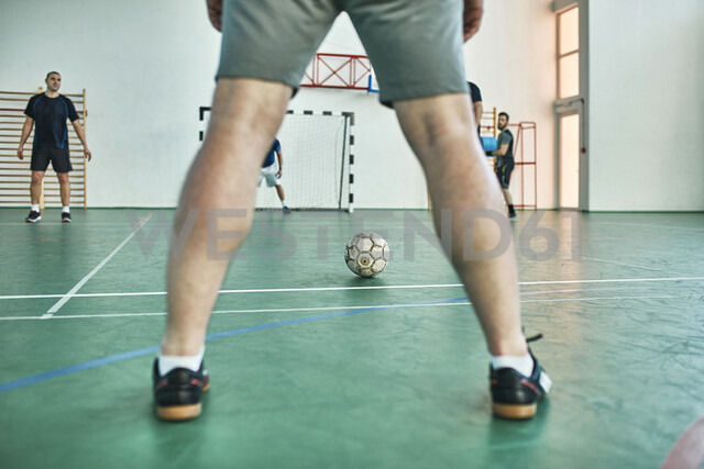 Men playing indoor soccer - ZEDF01413