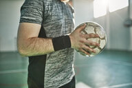 Close-up of indoor soccer player holding the ball - ZEDF01422
