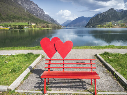 Italy, Lombardy, Idro lake, Adamello Alps, Parco Naturale Adamello Brenta, red bench with hearts - LAF02031