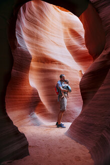 USA, Arizona, Father with baby on a baby carrier visiting Antelope Canyon - GEMF01961