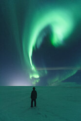 Mature man standing, watching Northern Lights, Mosfellsheidi, Iceland - CUF04564