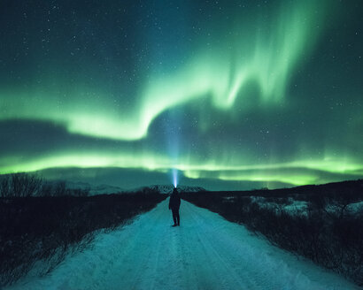 Mature man standing, watching Northern Lights, Thingvellir, Iceland - CUF04567