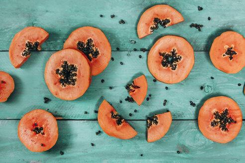 Sliced papaya on blue wood - RTBF01270