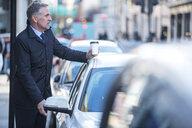 Man getting into car - CUF04901