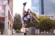 Dancer kicking and balancing on one leg, Cape Town, South Africa - CUF05484