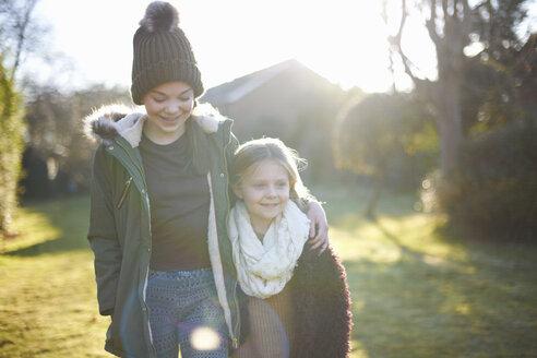Siblings enjoying sun in garden - CUF05601