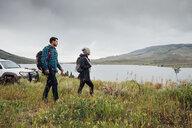 Couple walking beside Dillon Reservoir, Silverthorne, Colorado, USA - ISF01341