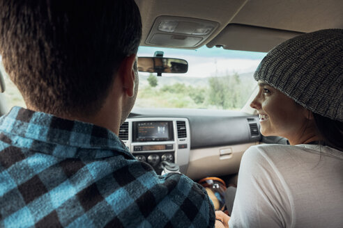 Couple in car, on road trip, rear view, Silverthorne, Colorado, USA - ISF01344