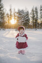Portrait of young girl standing in snow - ISF01394