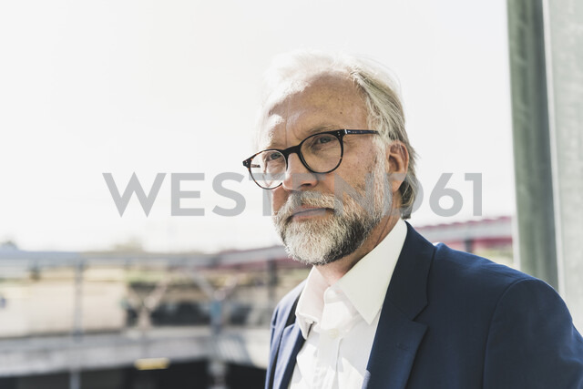 Portrait of serious mature businessman looking around - UUF13655