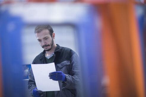 Engineer looking at paperwork - CUF05786