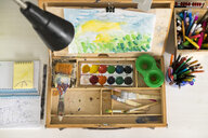 Box of paint, paintbrushes, drawing and assortment of colour pencils and painting tools - CUF06176