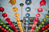 South Korea, Seoul, colorful lanterns, Busan Tower in the background - GEMF01982