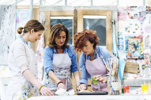 Three women working in creative studio - CUF07083