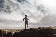 Woman standing on rocks, looking at view, Santa Cruz de Tenerife, Canary Islands, Spain, Europe - CUF07236