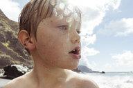 Young boy on beach, close-up, Santa Cruz de Tenerife, Canary Islands, Spain, Europe - CUF07239