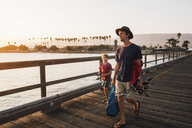 Father and son on pier with fishing rods, Goleta, California, United States, North America - CUF07245
