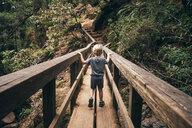 Rear view of boy crossing pedestrian bridge, Fairfax, California, USA, North America - CUF07263