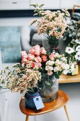 Cut flower display on coffee table in florist shop - CUF07341