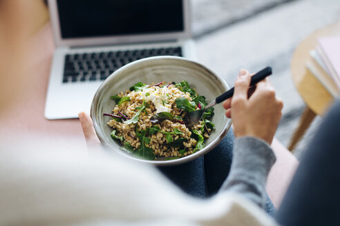 Cropped view of woman with meal using laptop - CUF07431