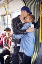 Romantic young couple hugging on city tram - CUF07485