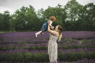Mother and daughter in lavender field, Campbellcroft, Canada - CUF07709