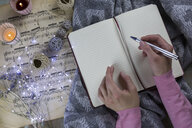 Hands of woman writing in notebook - JUNF01053