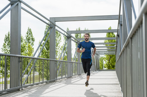 Man running on a bridge - DIGF04241