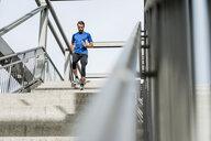 Man running down stairs - DIGF04244
