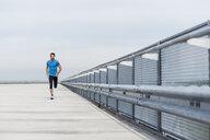 Man running on a parking level - DIGF04256