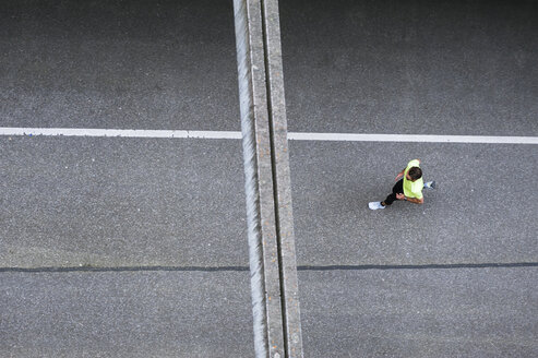 Top view of man running on a street - DIGF04259