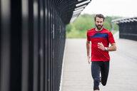 Man running on a bridge - DIGF04274