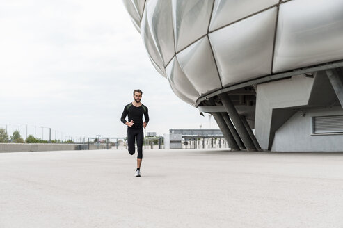 Man running at stadium - DIGF04295
