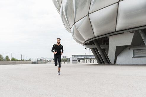 Man running at stadium - DIGF04295