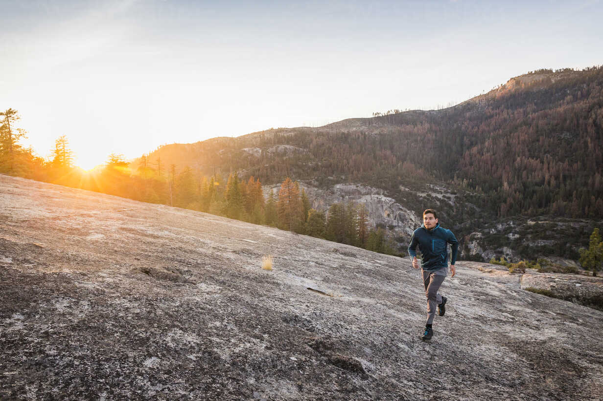 Man running on rock surface at sunset, Yosemite National Park, California, USA - CUF07871 - Manuel Sulzer/Westend61