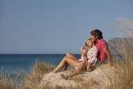 Couple relaxing on beach - CUF07943