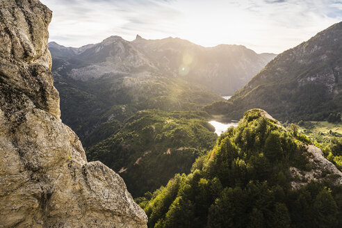 Sunlit mountain valley landscape and rock formations,  Futaleufu, Los Lagos region, Chile - CUF08089
