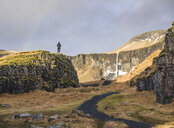 Man standing on rock, looking at view, Dvergahamrar, Iceland - CUF08359