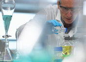 Biotechnology, scientist preparing a chemical formula during an experiment in the laboratory - CUF08542