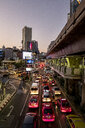 Thailand, Bangkok, traffic on main road in the evening - MMI00056