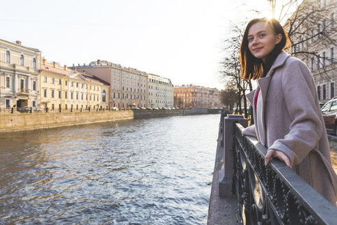 Russia, St. Petersburg, young woman next to a canal - WPEF00257