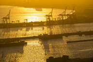 Africa, South Africa, Cape Town, Dockyard with cranes and ships at sunset - ZEF15425