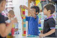 Boys stacking building blocks in kindergarten - ZEF15434