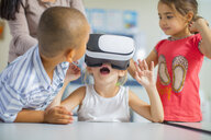Children in kindergarten with VR glasses - ZEF15458